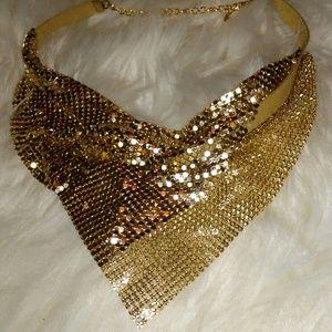 Gold color necklace.